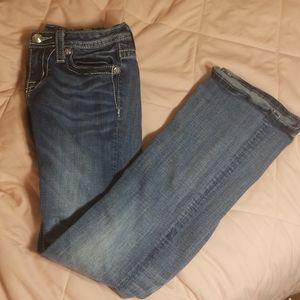 Miss Me Jean's camo pattern boot cut jeans